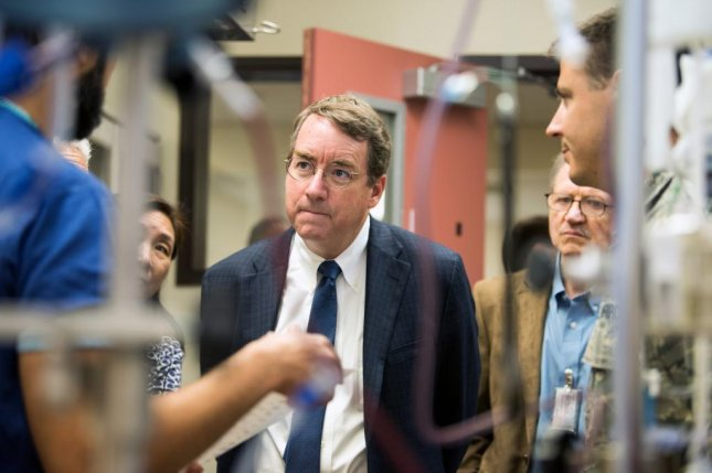 Dr. David Loftus, NASA Ames Research Center medical officer and principal investigator of the Space Biosciences Research Branch, NASA Ames Research Center, Silicon Valley, Calif., meets with members of the 60th Medical Group at Travis Air Force Base, Calif., June 1, 2018. Loftus presented the first working prototype of the E-Nose Breathalyzer, a handheld device developed by NASA at a symposium at David Grant USAF Medical Center Wednesday. Travis Airmen are hosting the NASA technology and collaborative research at the DGMC clinical investigation facility. Photo by Louis Briscese/U.S. Air Force