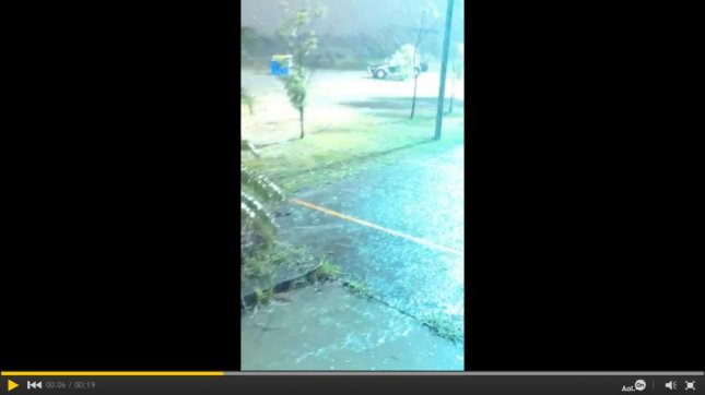 A bolt of lightning strikes a sport-utility vehicle in Rutherford, Australia, during a Dec. 10 hailstorm. Storyful video screenshot
