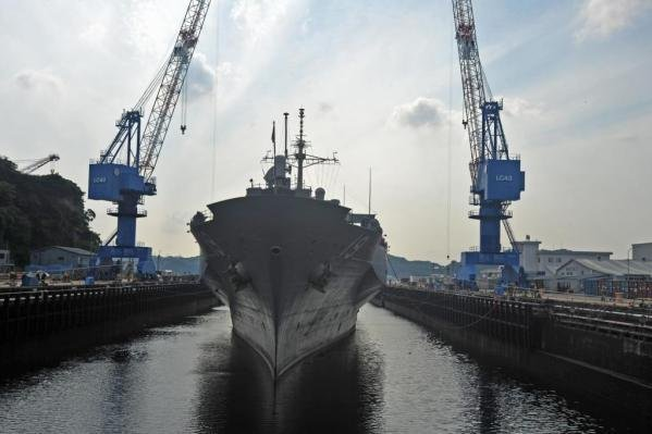 The U.S. Navy's USS Blue Ridge pulls into dry dock at Naval Ship Repair Facility and Japan Regional Maintenance Center in Yokosuka, Japan. The warship was the site of at least one sex party related to the Fat Leonard scandal that occurred when it was docked in the Philippines in 2007. File Photo courtesy U.S. Navy