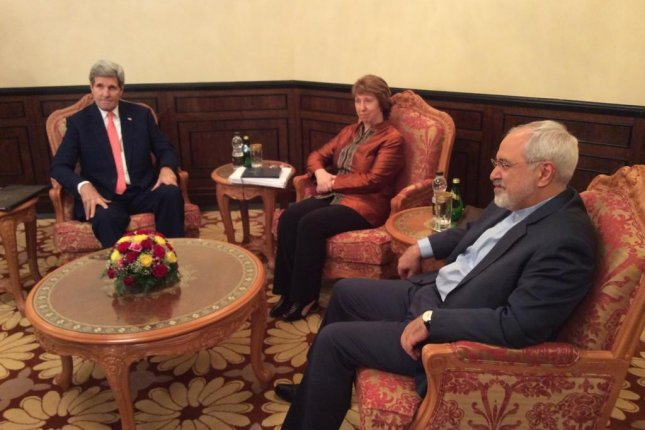 U.S. Secretary of State John Kerry, European Union foreign policy chief Catherine Ashton and Iranian Foreign Minister Javad Zarif meet in Muscat, Oman, on Nov. 10, 2014 for tri-lateral Iranian nuclear talks. UPI/Twitter/Marie Harf