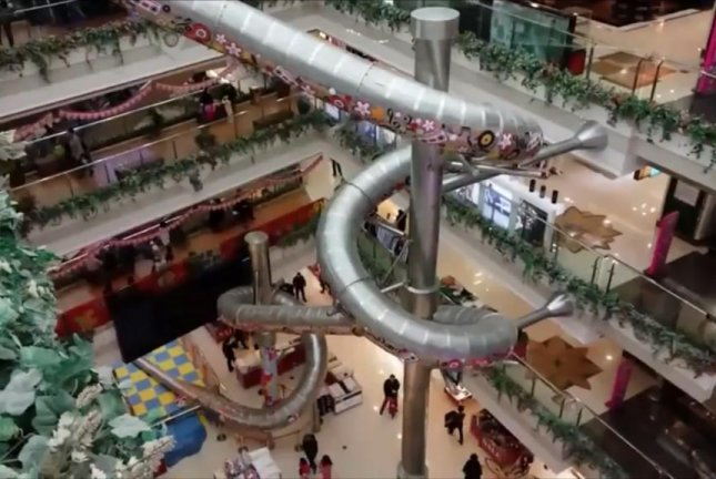 Watch shanghai mall gets 66 foot steel slide for Shopping in cina
