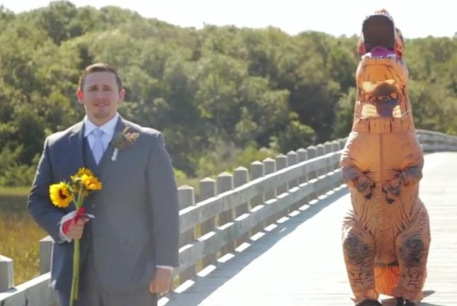 This North Carolina groom is in for a shock when he turns around to see his bride is a dinosaur. Screenshot: Storyful