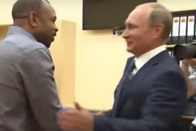 American boxer Roy Jones asked Russian President Vladimir Putin to give him Russian citizenship during a meeting in Sevastopol, Wednesday. Snapshot photo by RuptlyTV