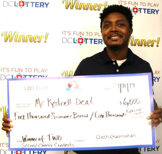 A Washington, D.C., man visited lottery headquarters to collect two jackpots from two different Second Chance games. Photo courtesy of the D.C. Lottery