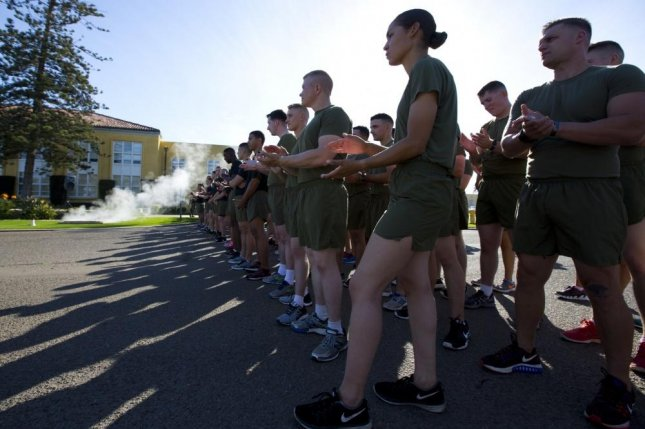 U.S. Marines with Headquarters and Service Battalion, Marine Corps Recruit Depot (MCRD) San Diego, stand in formation before a celebration run at MCRD San Diego, Calif., in November 2016. Photo by Robert G. Gavaldon/U.S. Marine Corps