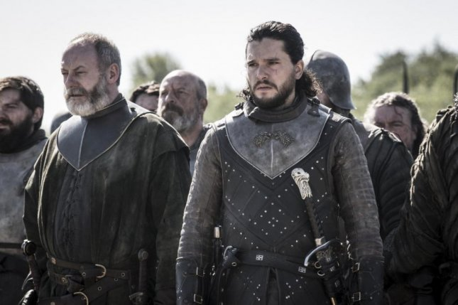 Actors Liam Cunningham (L) and Kit Harington appear in a scene from the series finale of Game of Thrones. Photo by Helen Sloan/HBO