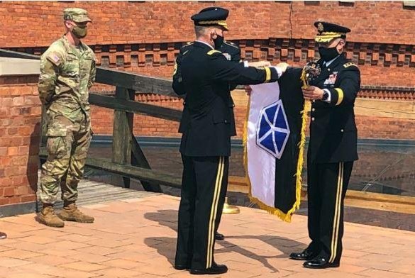 The flag of the U.S. Army's V Corps was unfurled in ceremonies on Tuesday in Krakow, Poland, the start of a new command post headquarters there. Photo courtesy of U.S. Army Europe