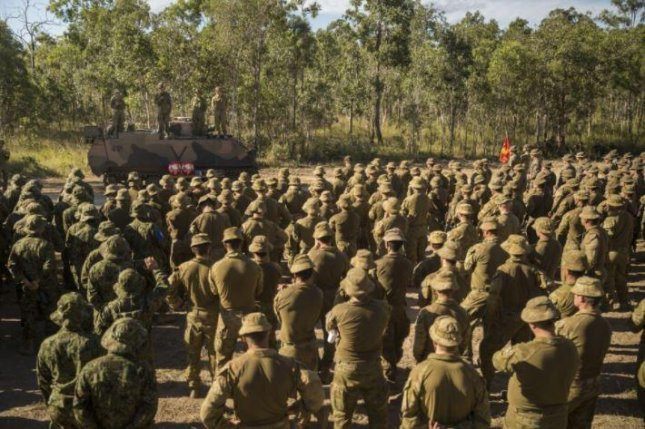 U.S. Marines gather at the conlusion of Exercise Southern Jackaroo earlier this month, a fields exercise in Australia with the Japan Ground Self-Defense Force and the Australian Army. Photo by SSgt. Jordan Gilbert/U.S. Marines
