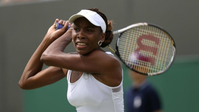 American Venus Williams returns in her match against Russia's Elena Vesnina on the first day of the 2012 Wimbledon championships in London, June 25 2012. UPI/Hugo Philpott