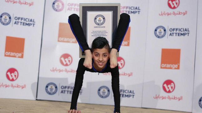 Mohammed Alsheikh, a 13-year-old boy from Palestine known as Spider Boy, used his flexible spine and contortionist skills to break the Guinness World Record for Most full body revolutions maintaining a chest stand in one minute. He was able to walk his legs around his body 38 times, besting the previous record of 29. Photo courtesy Guinness World Records