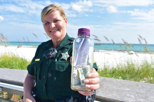 A Florida sheriff's deputy said a message in a bottle found on a Gulf of Mexico beach contained the ashes of a beloved family member of the message's authors and will be returned to the water from a charter boat. Photo courtesy of the Walton County Sheriff's Office