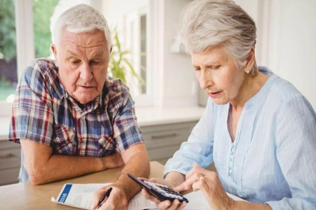 More than half of seriously ill Medicare beneficiaries said they'd had major trouble paying medical bills. Photo courtesy of HealthDay News