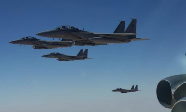 F-15 fighter planes of Israel, Qatar and Saudi Arabia joined a U.S. Air Force B-52 bomber in a show of force over the Persian Gulf on Sunday. Photo courtesy of U.S. Air Forces Central
