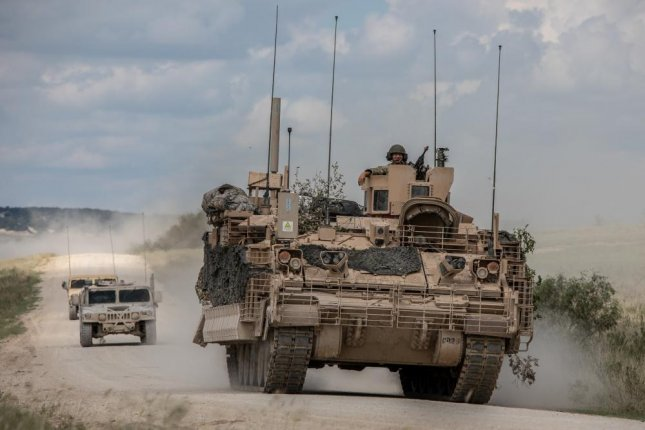 Soldiers from 4th Squadron, 9th U.S. Cavalry Regiment Dark Horse, 2nd Armored Brigade Combat Team, 1st Cavalry Division, are escorted by observer controllers from the U.S. Army Operational Test Command after completing field testing of the Armored Multi-Purpose Vehicle Sept. 24. (Photo Credit: Maj. Carson Petry (1st CAV))