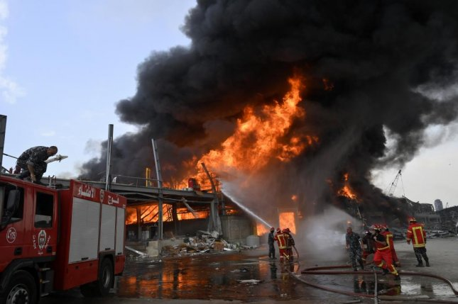 Crews work on Thursday to extinguish a fire at a warehouse in the Port of Beirut, Lebanon. Photo by Wael Hamzeh/EPA-EFE