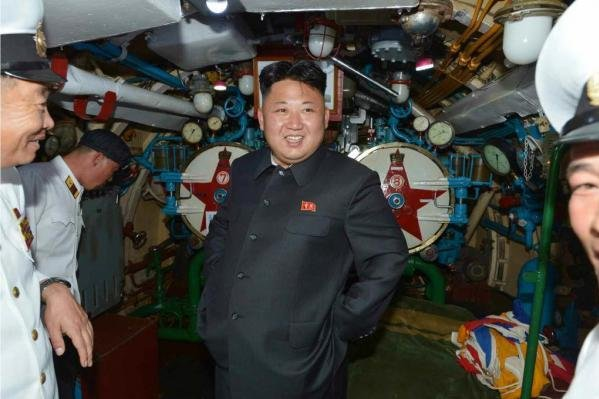 """Kim Jong Un inspecting a North Korean submarine in 2014. Kim Jong Un's celebratory weekend began early Friday when the North Korean leader agreed to accept a """"global statesman"""" award from Indonesia's Sukarno Center. File Photo by Rodong Sinmun/Yonhap"""