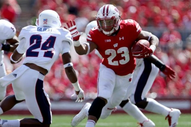 Jonathan Taylor (23) leads the Big Ten in rushing and ranks fifth in the nation, averaging 146.0 yards per game. He had a three-touchdown, 233-yard performance in his first start during the Badgers' 31-14 victory over Florida Atlantic on Sept. 9. He has 53 carries for 438 yards and five touchdowns. Photo courtesy of Wisconsin Badgers/Twitter