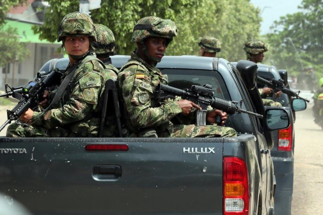 Colombian army soldiers guard against rebel forces in Tibu, northern Santander, Colombia. The ELN rebel faction said the temporary truce will last through April 30. File Photo by Mauricio Duenas Castaneda/EPA-EFE