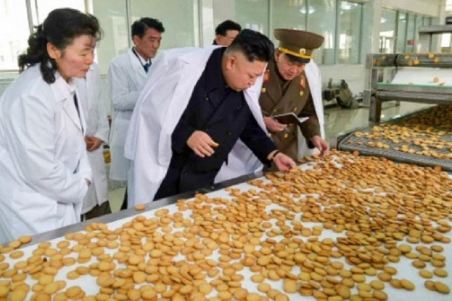 Kim Jong Un visiting a North Korean cookie factory in November 2014. Kim issued a gift bag of sweets to commemorate an anniversary, but the product is of poor quality, sources say. File Photo Rodong Sinmun