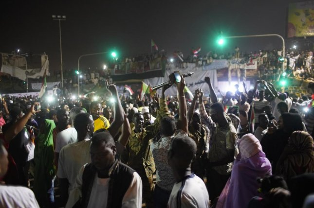 Sudanese people gather to celebrate in the streets of Khartoum, on Friday night after Awad Ibn Auf, Sudanese defense minister and head of Sudan's military council, stepped down a day after leading a military coup that ousted long-time leader Omar al-Bashir amid a wave of protests. Awad Ibn Auf named as his successor Lt. Gen. Abdel-Fattah Burhan. Photo by EPA