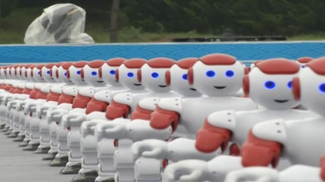 More than 1,000 robots perform a synchronized dance that may or may not be code for kill all humans. Screenshot: Newsflare