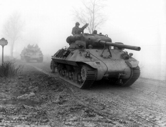 American M36 tank destroyers of the 703rd TD, attached to the 82nd Airborne Division, move forward during heavy fog to stem German spearhead near Werbomont, Belgium, 20 December 1944. Photo by U.S. Army