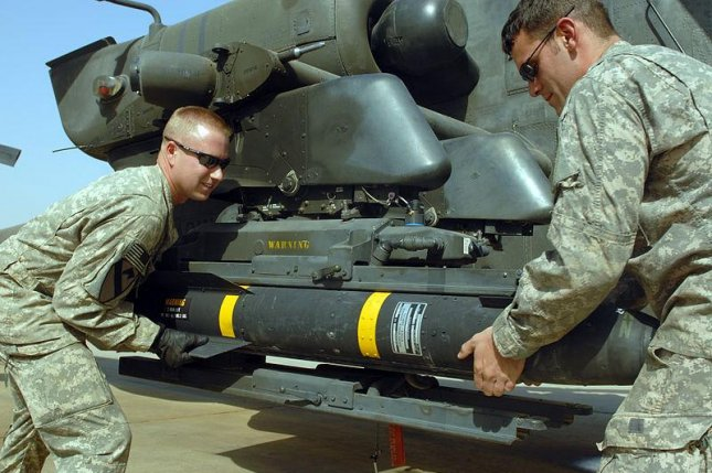 Hellfire missiles, seen here loaded onto a helicopter, are among the military equipment being sent to Iraqi forces (Cc/ wikimedia/ U.S. army)