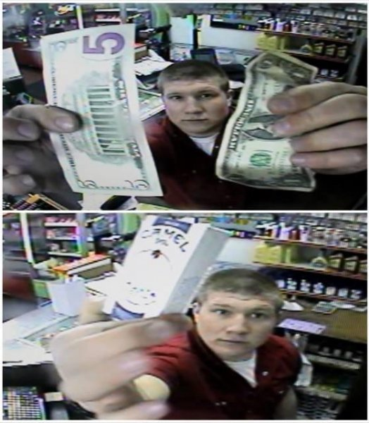 Ellis Battista holds up the cigarettes and $6 to a security camera at Bradley's convenience store in Las Cruces. Photo courtesy of the Las Cruces Police Department/Facebook