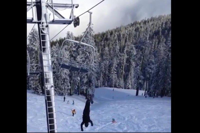 A Snowboarder Dangles From A Ski Lift In Oregon. Screenshot: Storyful