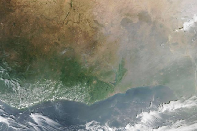 A satellite image shows the accumulation of smoke in the atmosphere from fires burning in western Africa. Photo by NASA Earth Observatory/Joshua Stevens/VIIRS data/Suomi NPP