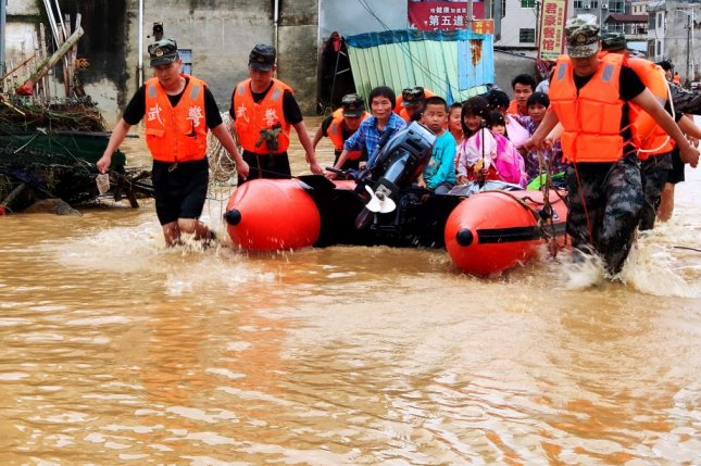 Rescuers transfer trapped people during flooding in Heyuan, Guangdong province, southern China, on Monday. Photo by STR/EPA-EFE
