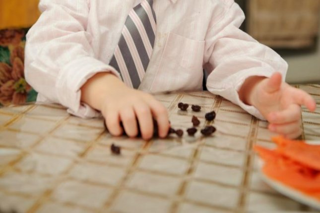 Whether or not a toddler can wait an instructed 60 seconds before taking a raisin predicts later academic performance. Photo by stocknadia/Shutterstock