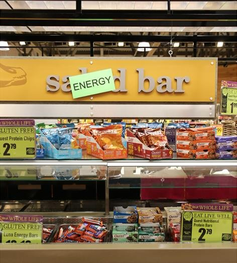 PHOTOS: Grocery store chain re-purposes salad bars to serve booze, cereal,  candy - UPI.com