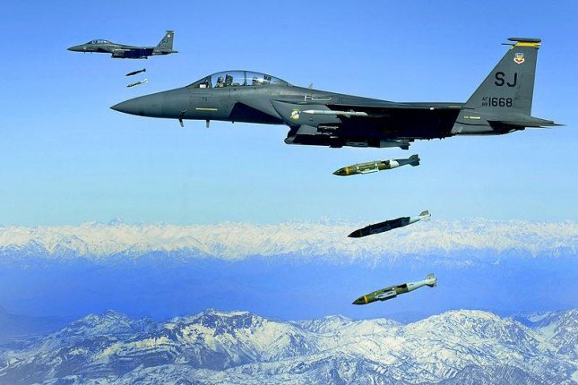 An F-15 drops JDAM-equipped bombs in Afghanistan. U.S. Air Force photo by Staff Sgt. Michael B. Keller