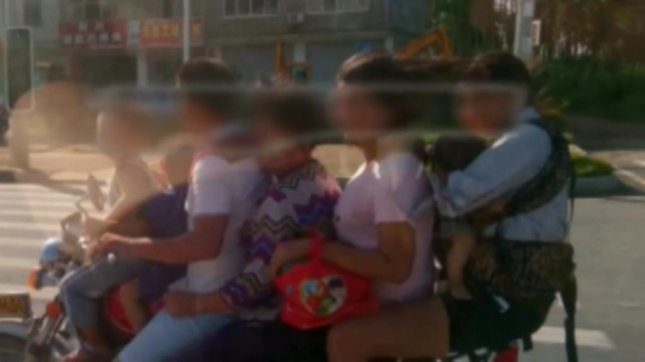 Seven people ride together on a motorcycle in China. Screenshot: Newsflare
