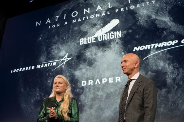 Amazon and Blue Origin founder Jeff Bezos (R) announced Tuesday a new partnership of companies to mount a lunar landing mission. Photo courtesy of Blue Origin