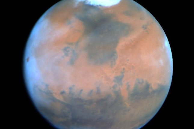 Mars' atmosphere became supersaturated with water vapor during the warmest portion of its orbit, according to a new study. Photo by NASA/ESA/Hubble