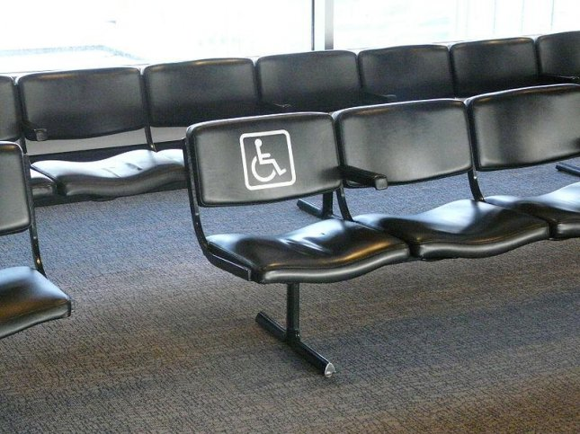 An airport terminal chair marked for disabled access. (CC/Piotrus)