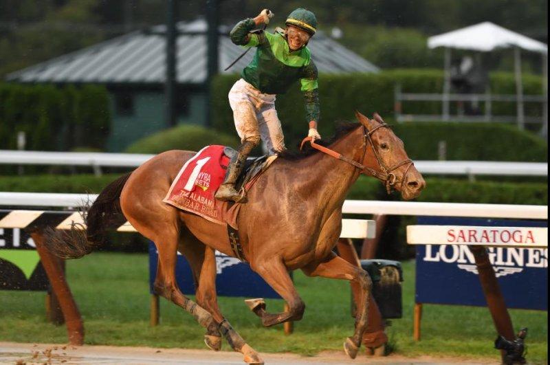 Jockey Jose Ortiz celebrates Dunbar Road's victory in the Grade I Alabama on a rainy Saturday at Saratoga. Photo courtesy of New York Racing Association
