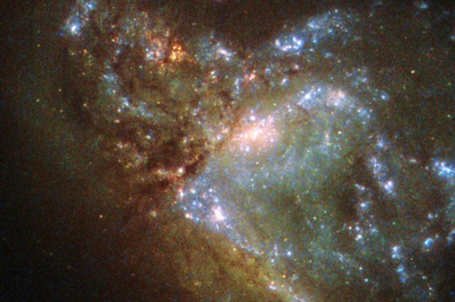 Scientists only recently realized they were looking at two galaxies merging, and not just a galaxy with a really weird shape. Photo courtesy of NASA/ESA/Hubble