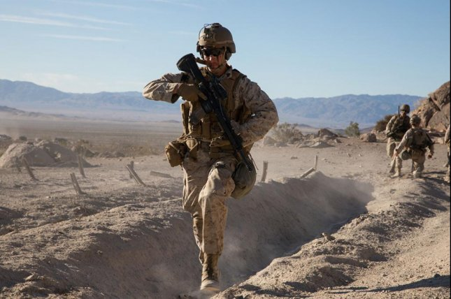 U.S. Marine Corps Sgt. Sean Nash, a rifleman with 1st Marine Division, provides cover fire while wearing the Plate Carrier Generation III during the Integrated Training Exercise at Marine Air Ground Combat Center Twentynine Palms, Calif., in January. Photo by Jack C. Howell/U.S. Marine Corps