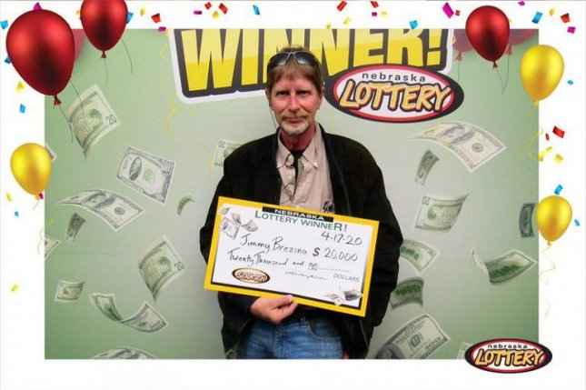 A Nebraska man who won a $20,000 jackpot from a scratch-off lottery ticket said his life was saved by a Nebraska Lottery T-shirt a few years earlier. Photo courtesy of the Nebraska Lottery