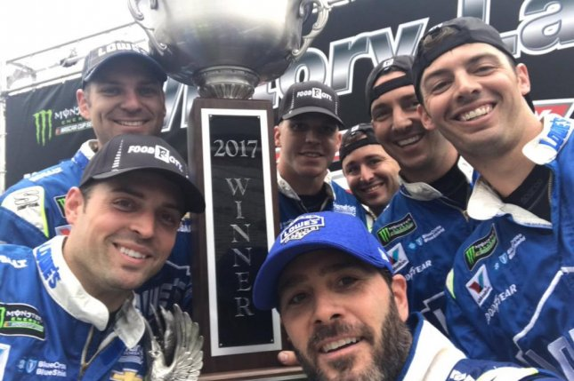 Jimmie Johnson and his crew pose with the trophy from the Food City 500, which was pushed to Monday because of weekend rain. Photo courtesy Jimmie Johnson via Twitter