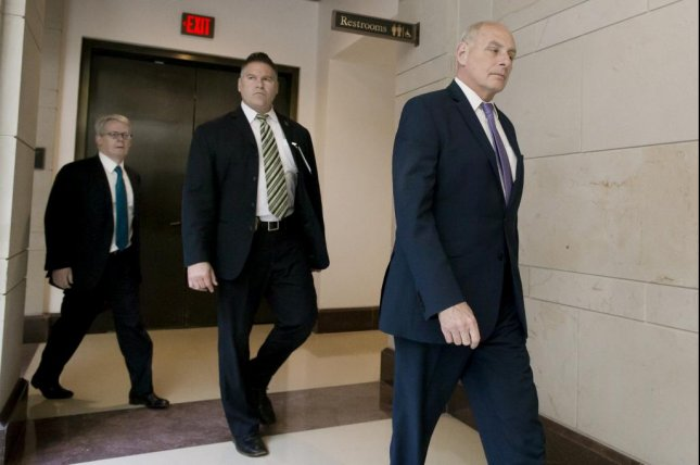 Emmet Flood (L), seen here with ex-White House chief of staff John Kelly (R) in May, 2018, will be leaving President Donald Trump's legal team this month, the president said Saturday. Photo by Michael Reynolds/EPA-EFE