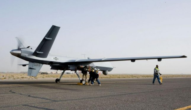 An MQ-9 Reaper unmanned aerial vehicle prepares to depart an airfield in Afghanistan. Photo courtesy of U.S. Air Force
