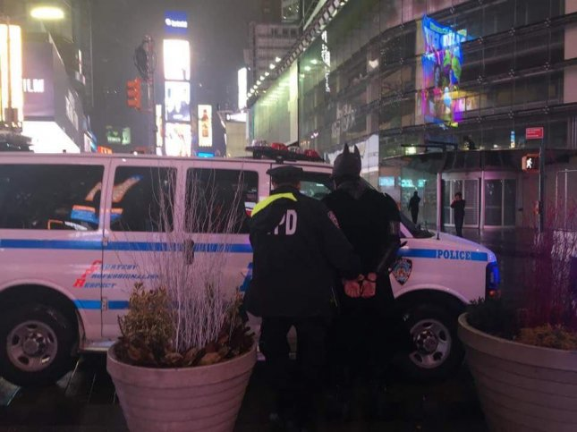 A man dressed as Batman in Times Square was arrested after attempting to steal $50 from a pair of Irish tourists who stopped to take a photo with him. Photo by ABetterTimesSquare/Twitter