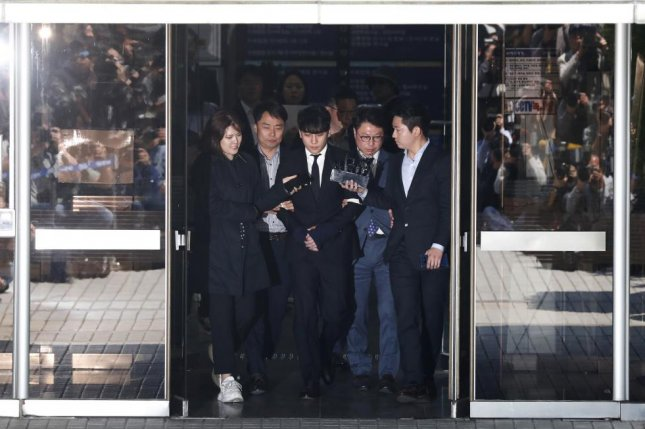 South Korean musician Lee Seung-hyun (C), or Seungri, has been questioned by police since March, on charges he is responsible for drugging and raping incidents at Burning Sun, a Seoul nightclub catering to wealthy clientele. File Photo by Jeon Heon-kyun/EPA-EFE