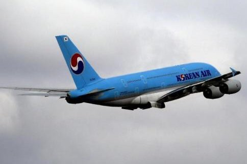 A Korean Air flight attendant said she was doused with wine when she tried to intervene in an argument between two passengers. File Photo by Barbara Walton/EPA