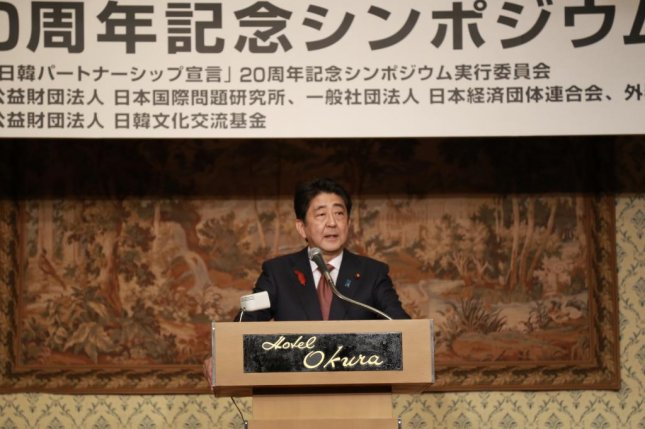 Japanese Prime Minister Shinzo Abe speaks during a symposium in Tokyo on Oct. 9, 2018, to mark the 20th anniversary of a joint declaration on a partnership issued by the then-leaders of South Korea and Japan. Photo by Yonhap