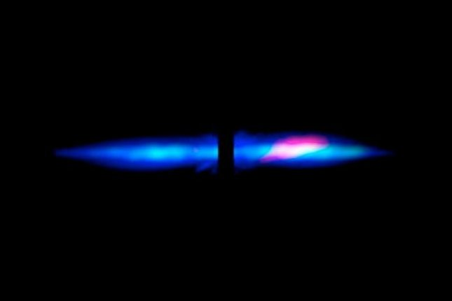 In this composite image of the large, edge-on, gas-and-dust disk encircling Beta Pictoris, visible light is blue, dust is green and carbon monoxide gas shows up as red. The image shows a curious asymmetry in the dust and gas distribution. This may be the result of a planetary collision within the disk, which may have pulverized the bodies. UPI/ NASA, ESA, D. Apai and G. Schneider/UA